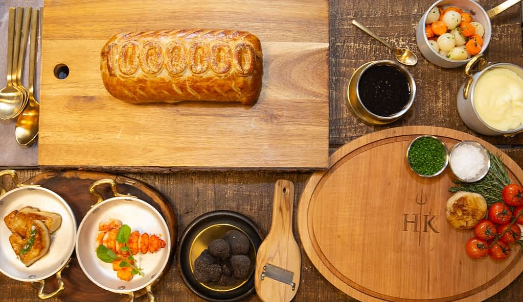 Beef Wellington with butter-poached lobster, foie gras and shaved black truffle